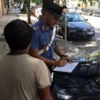 carabinieri parcheggiatori abusivi